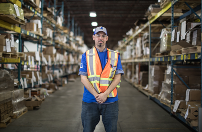 man standing in warehouse